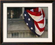 American Flag Draped Through A Window Framed Art Print