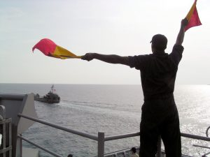 US_Navy_030611-N-3160B-003_Signalman_Seaman_Adrian_Delaney_practices_his_semaphore