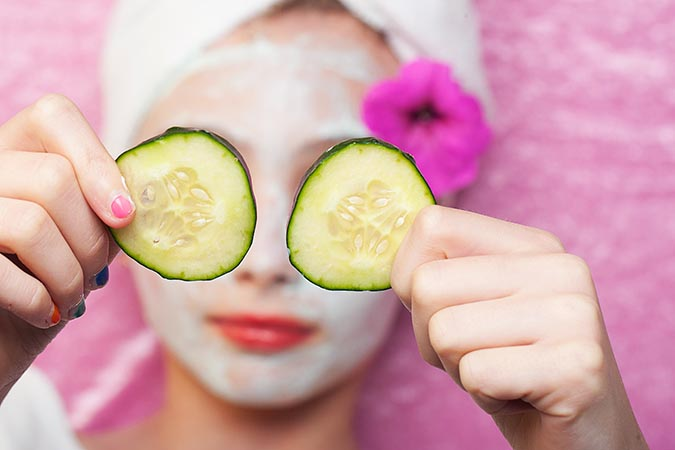cute-young-girl-getting-pampered-with-a-deluxe-spa-treatment-including-facial-mask-and-sliced-cucumber-over-her-eyes