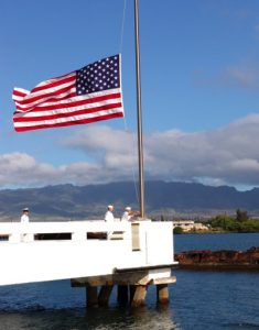 Pearl Harbor Memorial with flag flying at half staff
