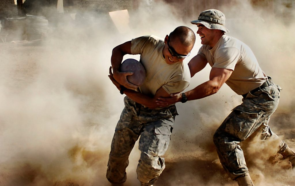 Army men playing football