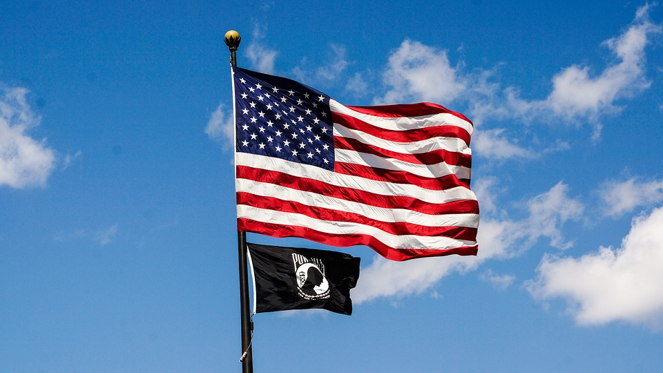 American flag flying with POW flag below it
