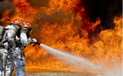 Firefighters battling flames