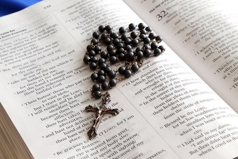 Rosary beads with cross on bible