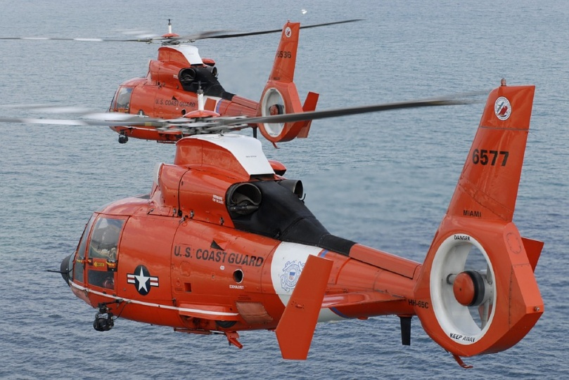 US Coast Guard helicopter in flight over sea