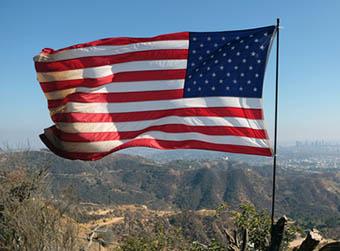 American flag flying wind
