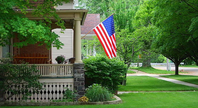 Mounted american flag on home porch