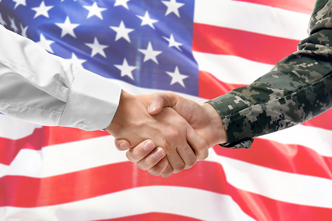 Shaking hands with american flag