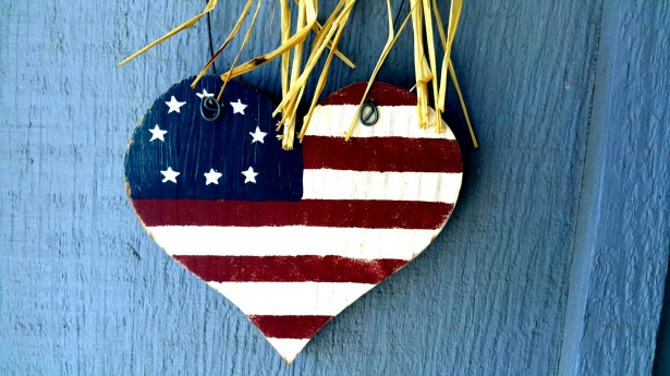 american flag painted on heart shaped wood