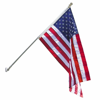 american flag hanging from pole with gold ball finial
