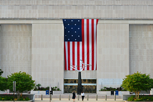 national museum of american history entrance with huge US flag