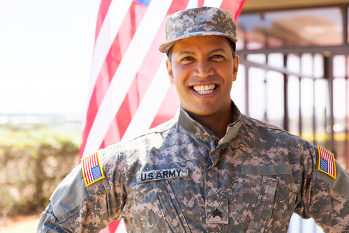 portrait of happy us army soldier outdoors