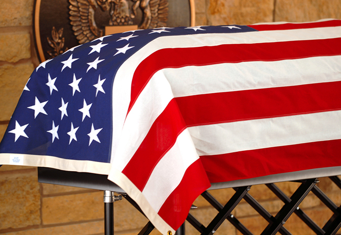 American flag covering casket