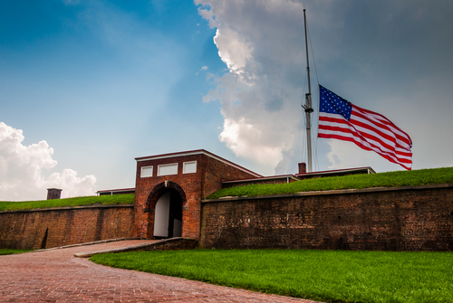 Summer storm clouds and American flag over Fort McHenry in Baltimore, Maryland