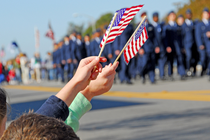 American flags at veterans day parade
