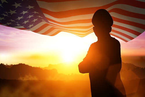 Silhouette of Soldier on the United States flag at sunset