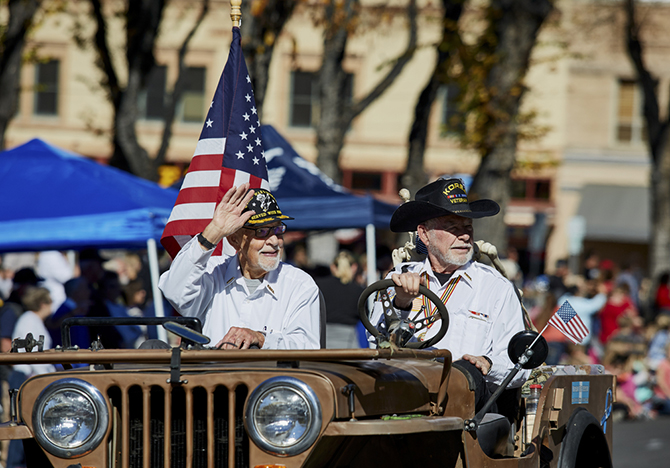 arizona veterans day parade with american flags