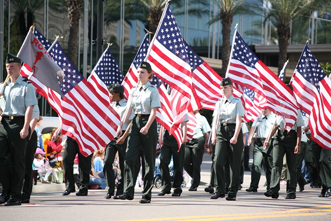 jacksonville veteran parade marchers with american flags