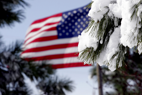 American Flag waving in a breeze after a snowstorm