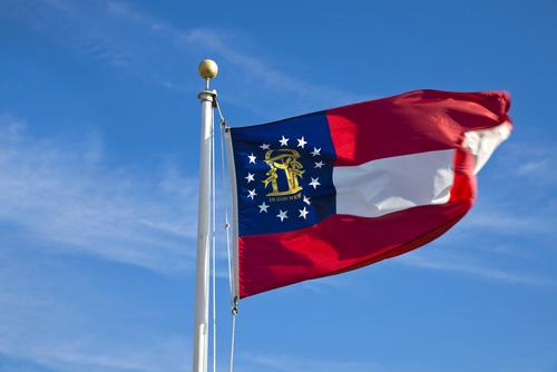 Georgia flag against blue sky