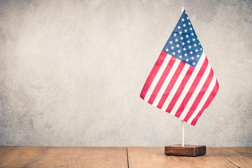 Retro USA flag on wooden table