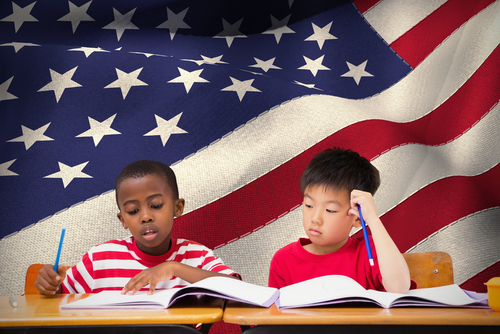 young boys writing american flag background