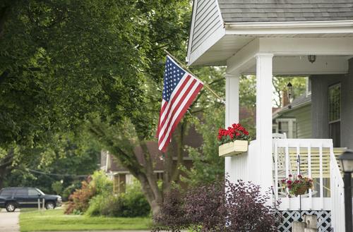 An American home proudly displaying their flag for a patriotic holiday