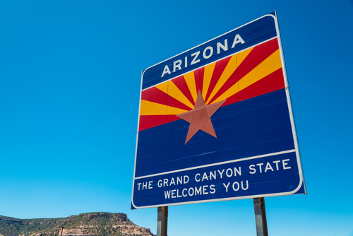 Arizona state border highway sign with a sky blue background