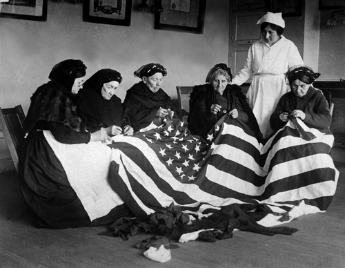 Patriotic elderly immigrant women making a flag during WWI