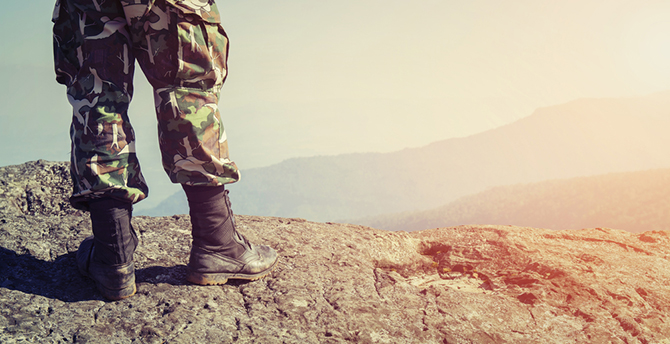 soldier top of mountain