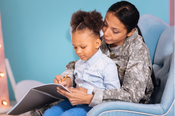 mother daughter writing to soldier