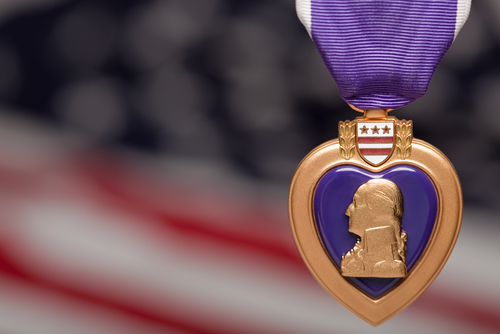 purple heart against american flag